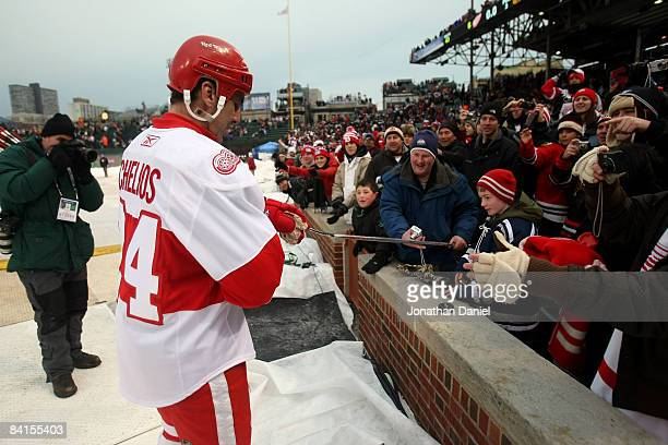 Chris Chelios of the Detroit Red Wings gives his game stick to a fan after the Red Wings 64 win against the Chicago Blackhawks during the NHL Winter...