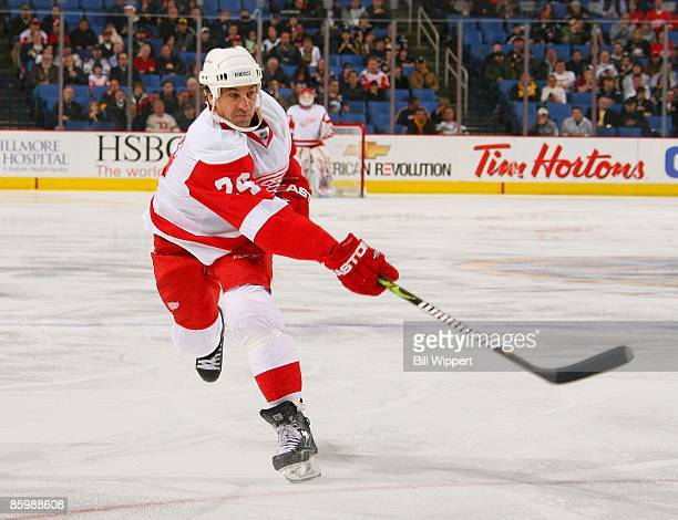 Chris Chelios of the Detroit Red Wings shoots the puck against the Buffalo Sabres on April 6 2009 at HSBC Arena in Buffalo New York