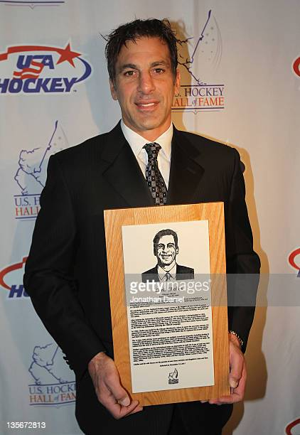 Chris Chelios poses with his plaque during a media availability before the 2011 US Hockey Hall of Fame Induction at the Renaissance Chicago Hotel on...