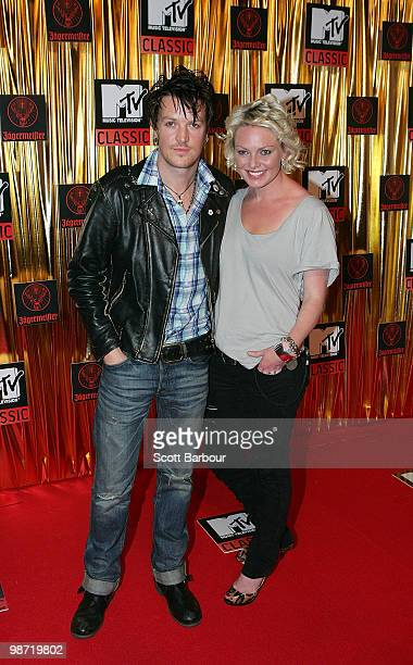Chris Cheney of The Living End and guest arrives at the 'MTV Classic The Launch' music event at the Palace Theatre on April 28 2010 in Melbourne...