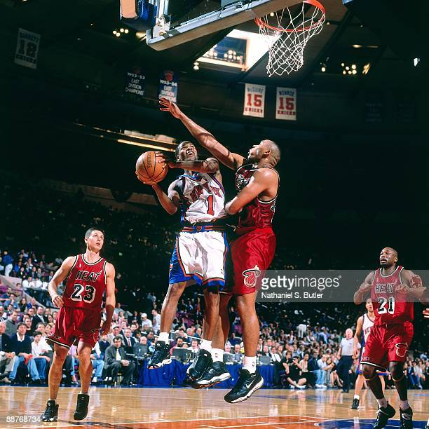 Chris Childs of the New York Knicks goes up for a shot against Clarence Weatherspoon of the Miami Heat in Game Three of the Eastern Conference...