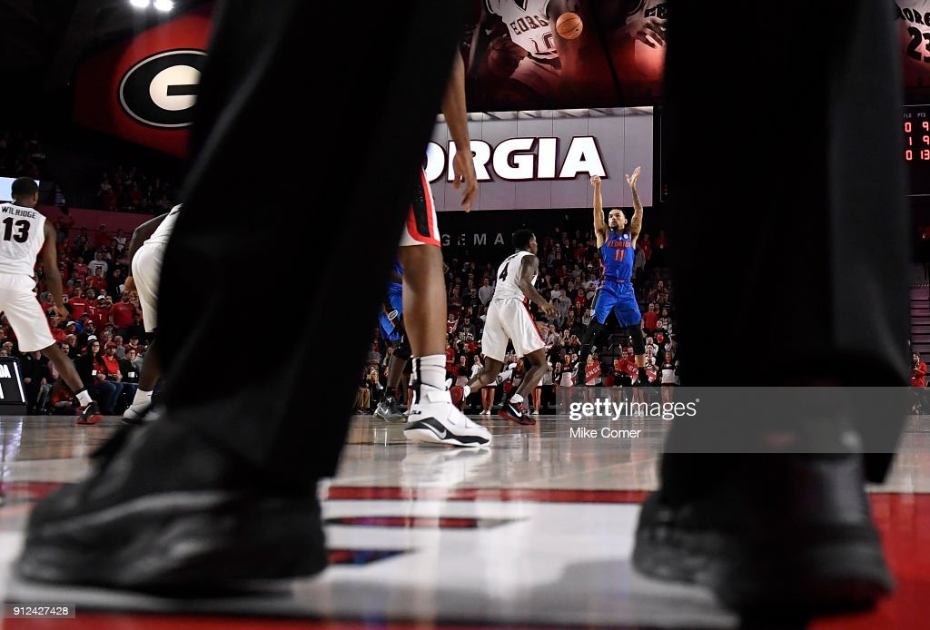 Chris Chiozza #11 of the Florida Gators shoots over Tyree Crump #4 of the Georgia Bulldogs during the basketball game at Stegeman Coliseum on January 30, 2018 in Athens, Georgia.