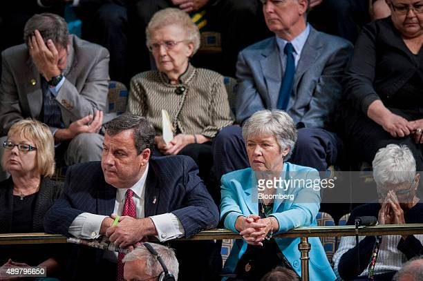 Chris Christie governor of New Jersey left listens as Pope Francis not pictured speaks to a joint meeting of Congress in the House Chamber at the US...