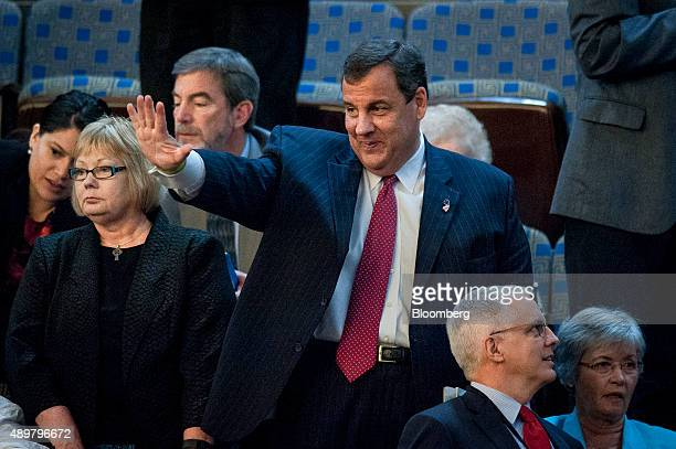 Chris Christie governor of New Jersey waves while waiting for Pope Francis not pictured to arrive for a joint meeting of Congress in the House...