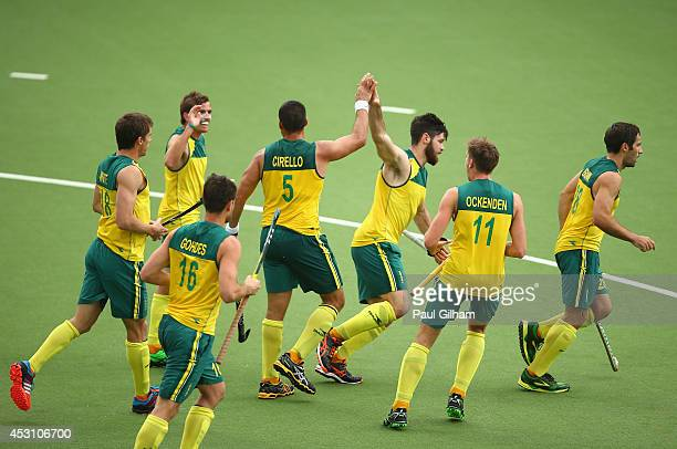 Chris Ciriello of Australia celebrates with his teammates after scoring the second goal for Australia in the Men's Gold Mdal Match Final between...
