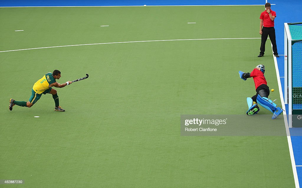 Chris Ciriello of Australia scores a penaty shot past Sreejesh Parattu Raveendran of India during the men's preliminaries match between India and Australia at the Glasgow National Hockey Centre during day six of the Glasgow 2014 Commonwealth Games on July 29, 2014 in Glasgow, United Kingdom.