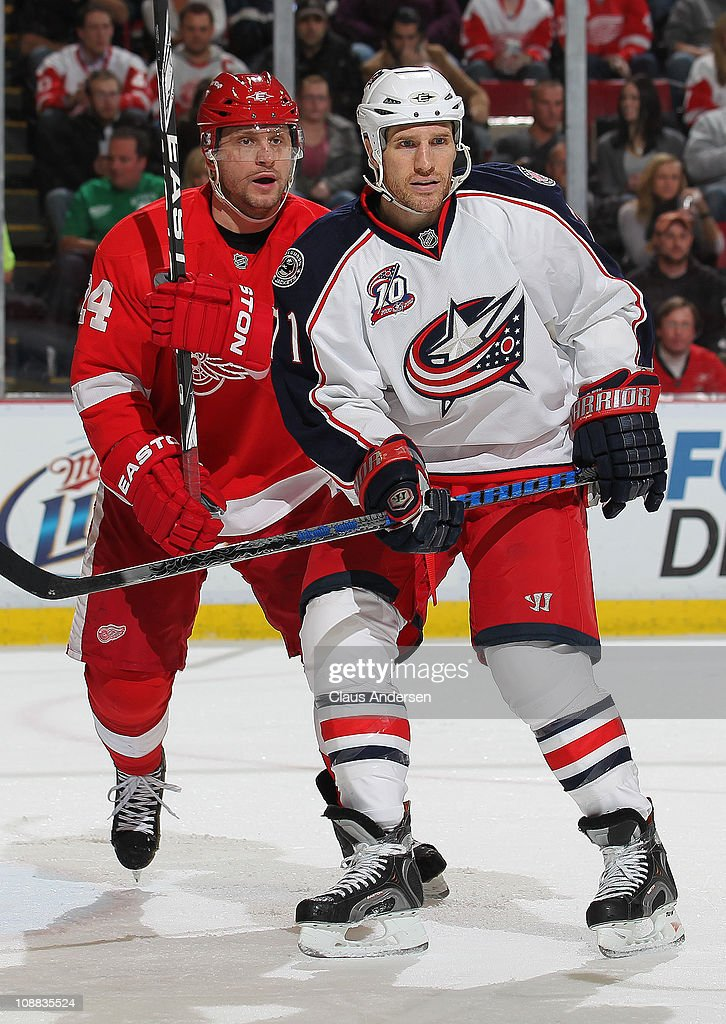 <a gi-track='captionPersonalityLinkClicked' href=/galleries/search?phrase=Chris+Clark+-+Ice+Hockey+Right+Winger&family=editorial&specificpeople=15119547 ng-click='$event.stopPropagation()'>Chris Clark</a> #71 of the Columbus Blue Jackets is held in check by <a gi-track='captionPersonalityLinkClicked' href=/galleries/search?phrase=Ruslan+Salei&family=editorial&specificpeople=589921 ng-click='$event.stopPropagation()'>Ruslan Salei</a> #24 of the Detroit Red Wings in a game on February 4, 2011 at the Joe Louis Arena in Detroit, Michigan. The Blue Jackets defeated the Wings 3-0.