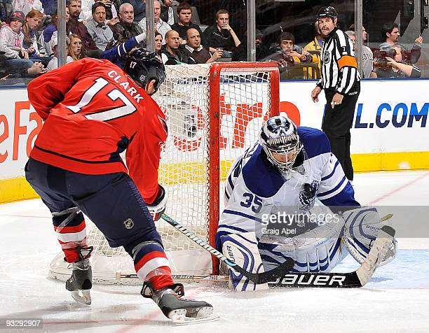 Chris Clark of the Washington Capitals is stopped in close by Vesa Toskala of the Toronto Maple Leafs during game action November 21 2009 at the Air...