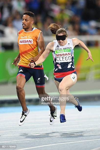 Chris Clarke and Libby Clegg of Great Britain compete in the women's 100m T11 final on day 2 of the Rio 2016 Paralympic Games at Olympic Stadium on...