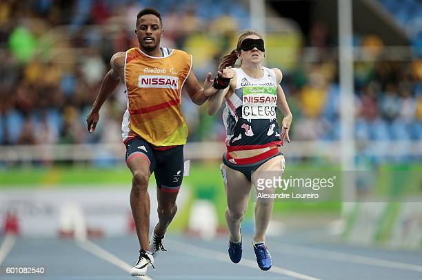 Chris Clarke and Libby Clegg of Great Britain in action during the women's 100m T11 Semifinals at the Olympic Stadium on Day 2 of the Rio 2016...