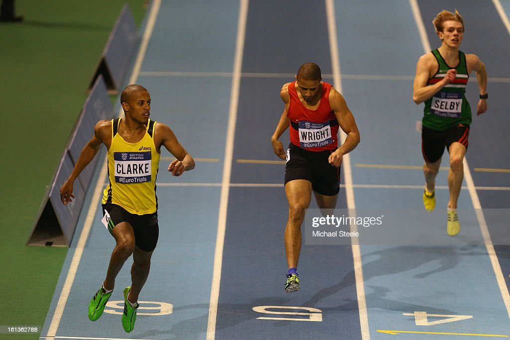 Chris Clarke (L) wins the men's final 200m final from Andre Wright (2L) during day two of the British Athletics European Trials & UK Championship at the English Institute of Sport on February 10, 2013 in Sheffield, England.