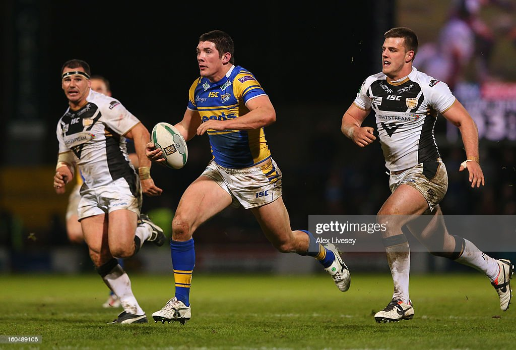 Chris Clarkson of Leeds Rhinos beats Joe Arundel of Hull FC during the Stobart Super League match between Leeds Rhinos and Hull FC at Headingley Carnegie Stadium on February 1, 2013 in Leeds, England.