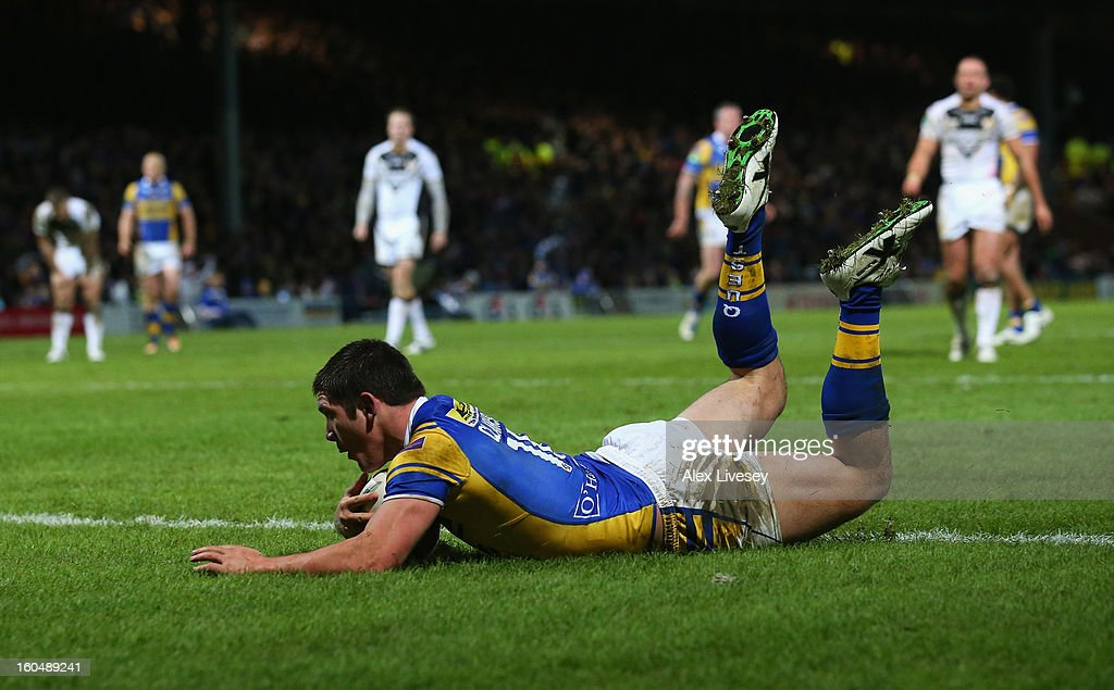 Chris Clarkson of Leeds Rhinos dives over the line to score his try during the Stobart Super League match between Leeds Rhinos and Hull FC at Headingley Carnegie Stadium on February 1, 2013 in Leeds, England.