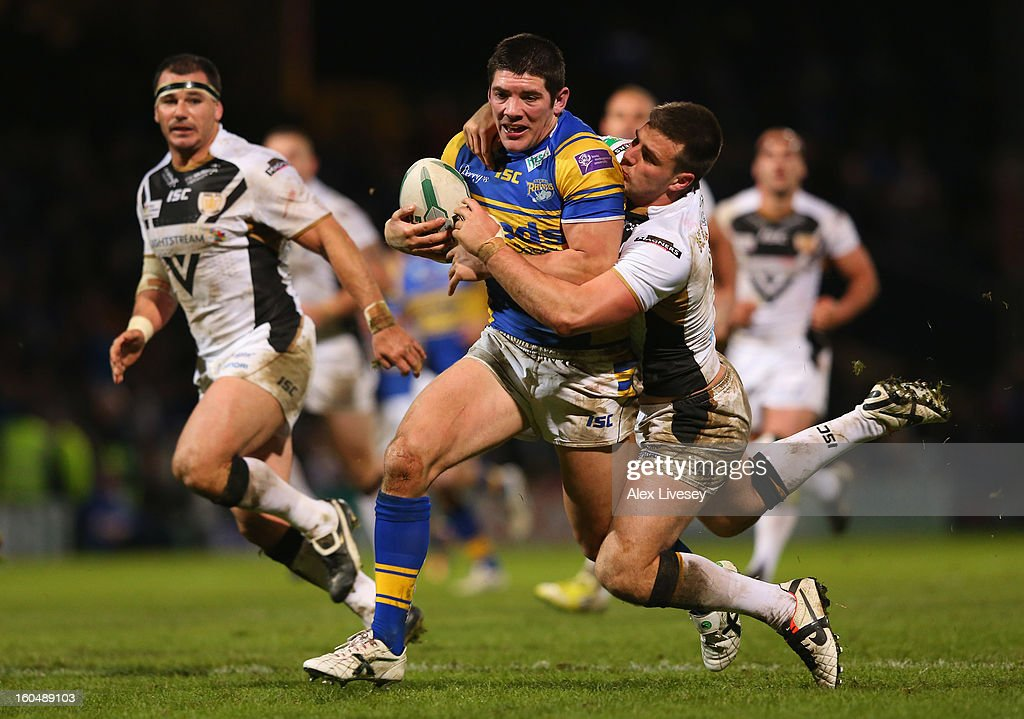 Chris Clarkson of Leeds Rhinos is tackled by Joe Arundel of Hull FC during the Stobart Super League match between Leeds Rhinos and Hull FC at Headingley Carnegie Stadium on February 1, 2013 in Leeds, England.