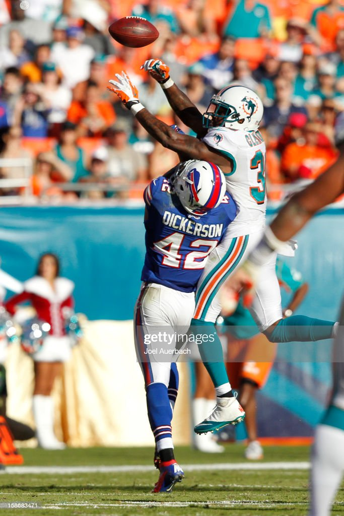 Chris Clemons #30 of the Miami Dolphins defends against Dorin Dickerson #42 of the Buffalo Bills on December 23, 2012 at Sun Life Stadium in Miami Gardens, Florida. The Dolphins defeated the Bills 24-10.
