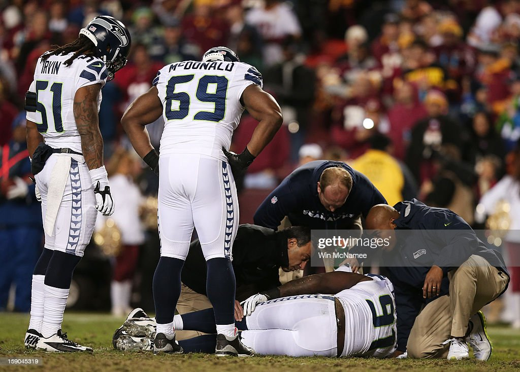 Chris Clemons #91 of the Seattle Seahawks receives medical attention after being injured on a third quarter play against the Washington Redskins during the NFC Wild Card Playoff Game at FedExField on January 6, 2013 in Landover, Maryland.