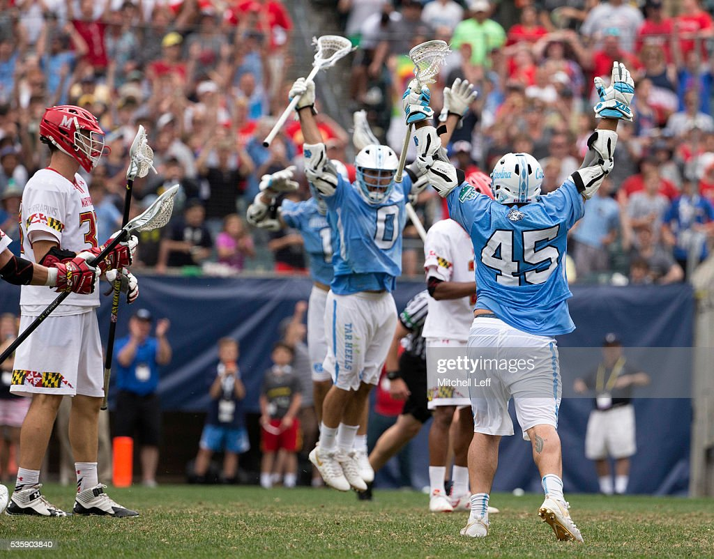Chris Cloutier #45 and Steve Pontrello #0 of the North Carolina Tar Heels react in front of Matt Dunn #33 of the Maryland Terrapins in the NCAA Division I Men's Lacrosse Championship at Lincoln Financial Field on May 30, 2016 in Philadelphia, Pennsylvania. The Tar Heels defeated the Terrapins 14-13.
