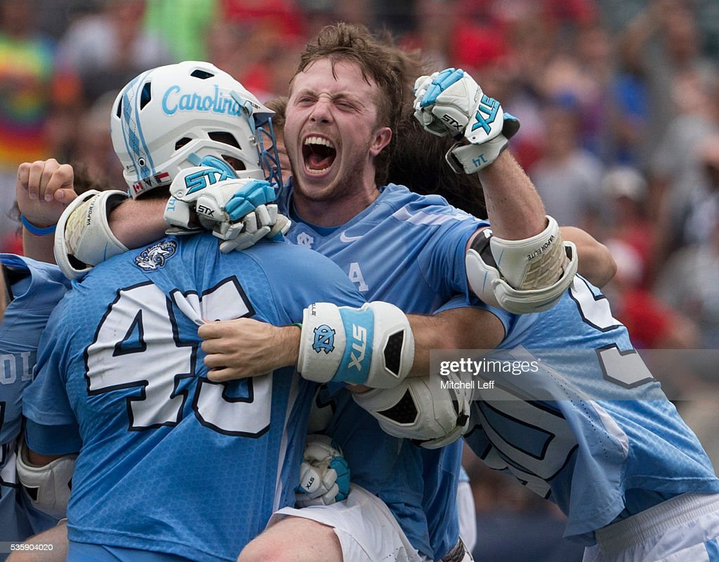 Chris Cloutier #45 and William McBride #14 of the North Carolina Tar Heels react after defeating the Maryland Terrapins in overtime in the NCAA Division I Men's Lacrosse Championship at Lincoln Financial Field on May 30, 2016 in Philadelphia, Pennsylvania. The Tar Heels defeated the Terrapins 14-13.