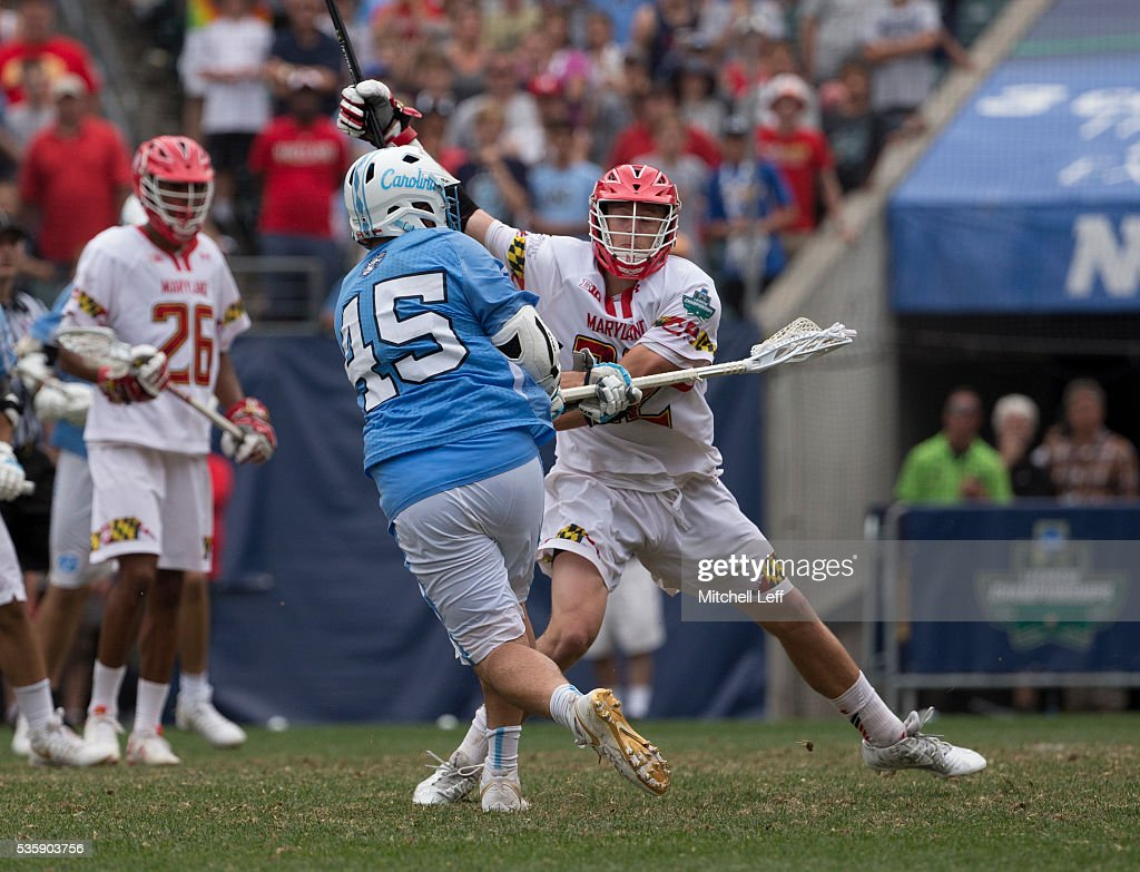 Chris Cloutier #45 of the North Carolina Tar Heels scores the game winning goal in overtime against Greg Danseglio #22 of the Maryland Terrapins in the NCAA Division I Men's Lacrosse Championship at Lincoln Financial Field on May 30, 2016 in Philadelphia, Pennsylvania. The Tar Heels defeated the Terrapins 14-13.