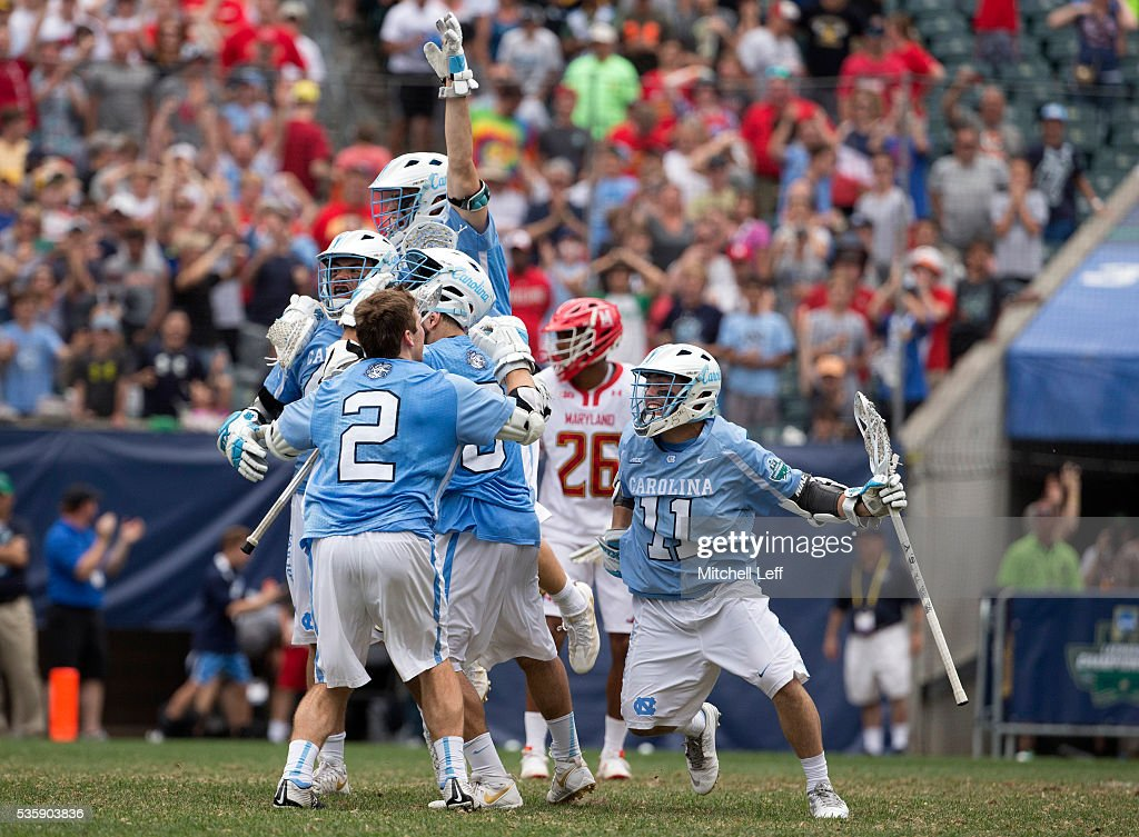 Chris Cloutier #45, Patrick Kelly #2, and Brian Cannon #11 of the North Carolina Tar Heels celebrate in front of Isaiah Davis-Allen #26 of the Maryland Terrapins after the Tar Heels defeated the Terrapins in overtime in the NCAA Division I Men's Lacrosse Championship at Lincoln Financial Field on May 30, 2016 in Philadelphia, Pennsylvania. The Tar Heels defeated the Terrapins 14-13.