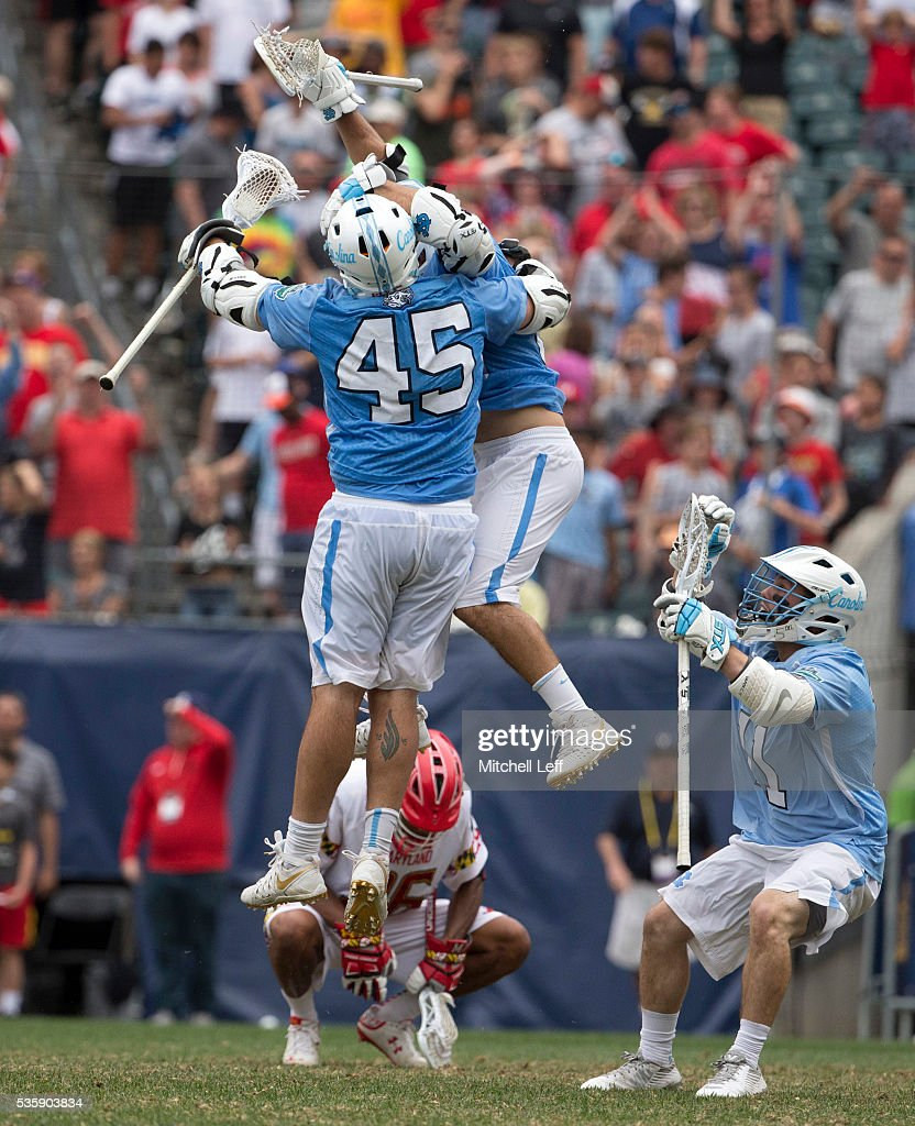 Chris Cloutier #45, Steve Pontrello #0, and Brian Cannon #11 of the North Carolina Tar Heels celebrate in front of Isaiah Davis-Allen #26 of the Maryland Terrapins in the NCAA Division I Men's Lacrosse Championship at Lincoln Financial Field on May 30, 2016 in Philadelphia, Pennsylvania. The Tar Heels defeated the Terrapins 14-13.