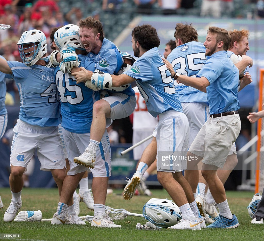 Chris Cloutier #45, William McBride #14, Kevin Walker #50, and Jesse Cuccia #35 of the North Carolina Tar Heels react after defeating the Maryland Terrapins in overtime in the NCAA Division I Men's Lacrosse Championship at Lincoln Financial Field on May 30, 2016 in Philadelphia, Pennsylvania. The Tar Heels defeated the Terrapins 14-13.