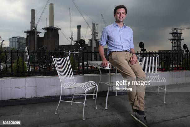 Chris Coghlan independent candidate standing in the Battersea constituency poses for a photograph in front of Battersea power station in London UK on...