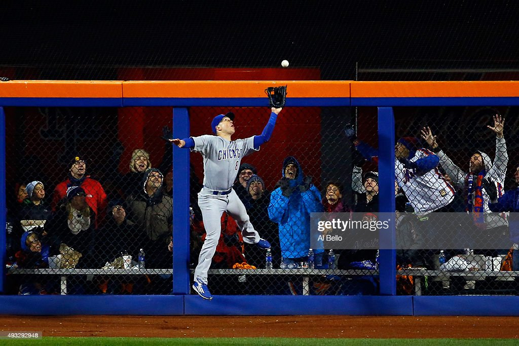 Chris Coghlan #8 of the Chicago Cubs catches a pop up fly hit by Yoenis Cespedes #52 of the New York Mets in the sixth inning during game two of the 2015 MLB National League Championship Series at Citi Field on October 18, 2015 in the Flushing neighborhood of the Queens borough of New York City.