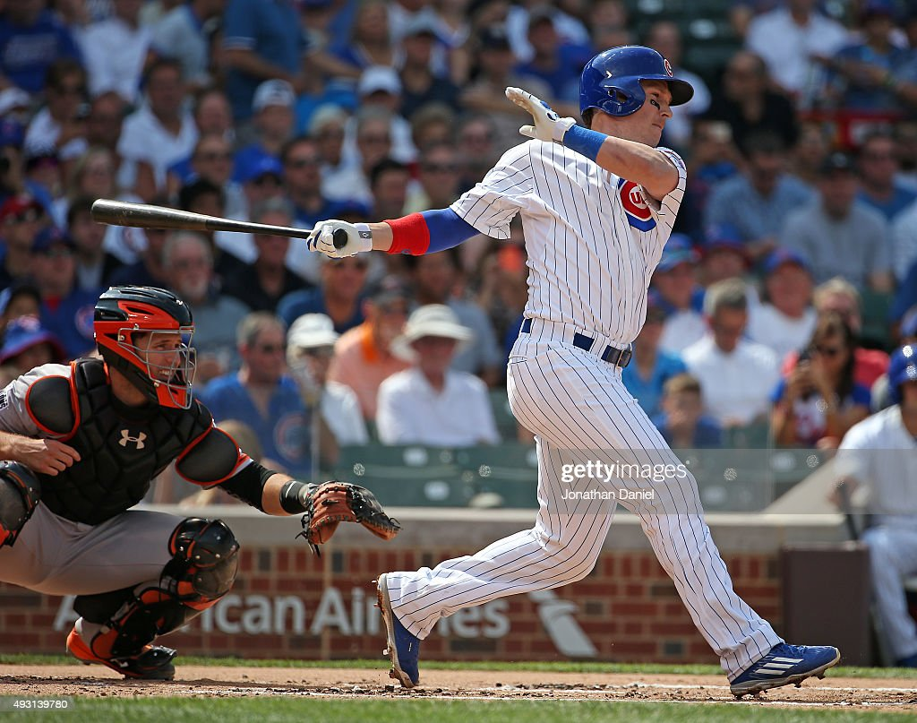 <a gi-track='captionPersonalityLinkClicked' href=/galleries/search?phrase=Chris+Coghlan&family=editorial&specificpeople=4391543 ng-click='$event.stopPropagation()'>Chris Coghlan</a> #8 of the Chicago Cubs hits a run-scoring single in the 1st inning against the San Francisco Giants at Wrigley Field on August 7, 2015 in Chicago, Illinois.