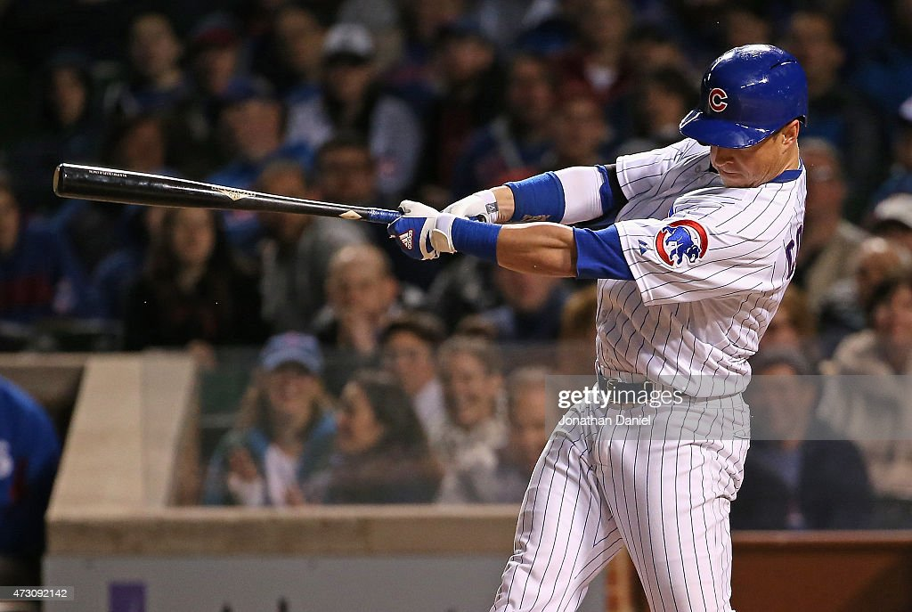 Chris Coghlan #8 of the Chicago Cubs hits a two-run home run in the 6th inning against the New York Mets at Wrigley Field on May 12, 2015 in Chicago, Illinois.