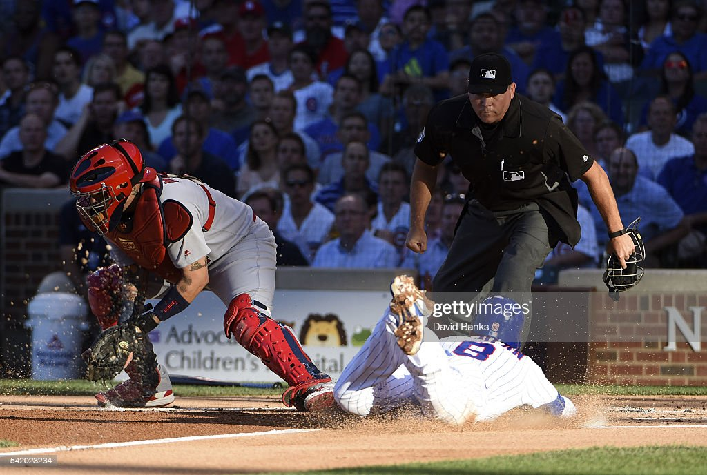 <a gi-track='captionPersonalityLinkClicked' href=/galleries/search?phrase=Chris+Coghlan&family=editorial&specificpeople=4391543 ng-click='$event.stopPropagation()'>Chris Coghlan</a> #8 of the Chicago Cubs is safe at home as <a gi-track='captionPersonalityLinkClicked' href=/galleries/search?phrase=Yadier+Molina&family=editorial&specificpeople=172002 ng-click='$event.stopPropagation()'>Yadier Molina</a> #4 of the St. Louis Cardinals takes a late throw during the first inning on June 21, 2016 at Wrigley Field in Chicago, Illinois.