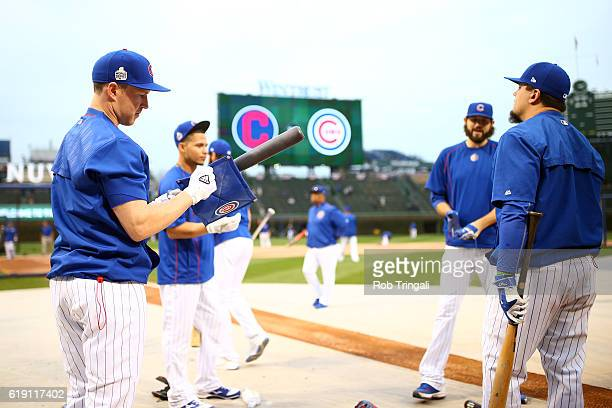 Chris Coghlan of the Chicago Cubs puts pine tar on his bat during batting practice prior to Game 4 of the 2016 World Series against the Cleveland...
