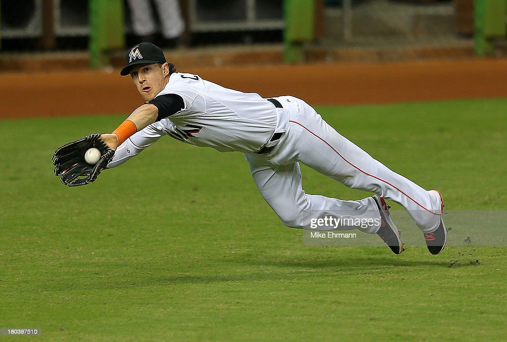 <a gi-track='captionPersonalityLinkClicked' href=/galleries/search?phrase=Chris+Coghlan&family=editorial&specificpeople=4391543 ng-click='$event.stopPropagation()'>Chris Coghlan</a> #8 of the Miami Marlins makes a diving catch during a game against the Atlanta Braves at Marlins Park on September 12, 2013 in Miami, Florida.