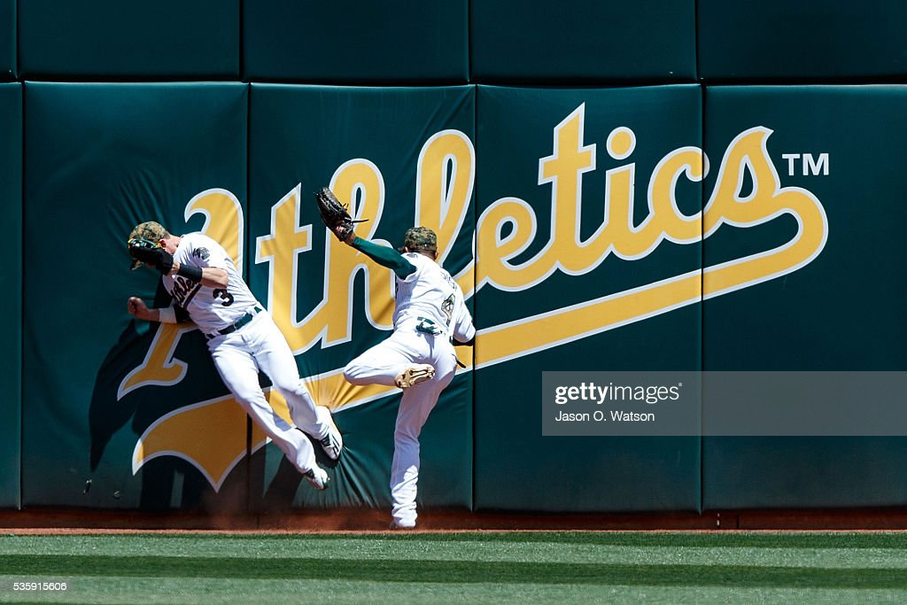 <a gi-track='captionPersonalityLinkClicked' href=/galleries/search?phrase=Chris+Coghlan&family=editorial&specificpeople=4391543 ng-click='$event.stopPropagation()'>Chris Coghlan</a> #3 of the Oakland Athletics collides with <a gi-track='captionPersonalityLinkClicked' href=/galleries/search?phrase=Coco+Crisp&family=editorial&specificpeople=206376 ng-click='$event.stopPropagation()'>Coco Crisp</a> #4 after catching a sacrifice fly ball hit off the bat Brian Dozier (not pictured) of the Minnesota Twins of during the fifth inning at the Oakland Coliseum on May 30, 2016 in Oakland, California. The Oakland Athletics defeated the Minnesota Twins 3-2.