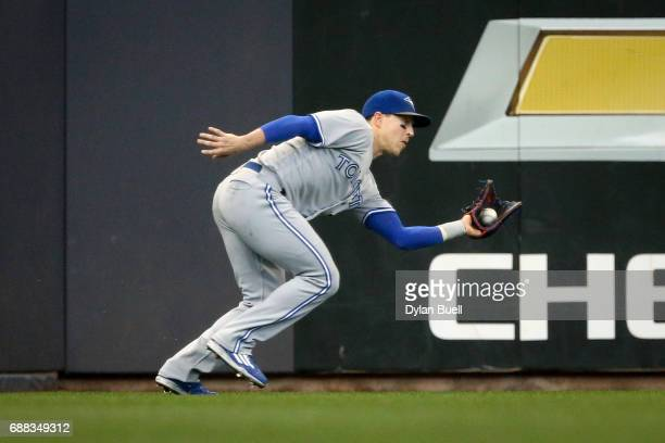 Chris Coghlan of the Toronto Blue Jays catches a fly ball in the second inning against the Milwaukee Brewers at Miller Park on May 24 2017 in...