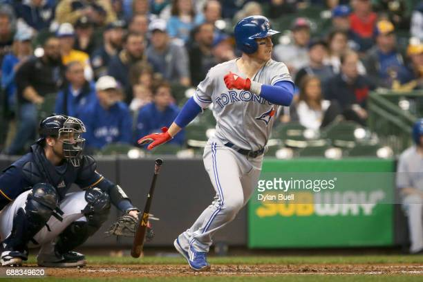 Chris Coghlan of the Toronto Blue Jays hits a single in the fifth inning against the Milwaukee Brewers at Miller Park on May 24 2017 in Milwaukee...