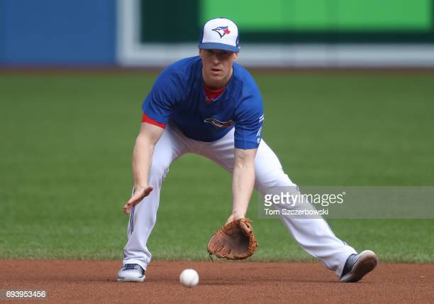 Chris Coghlan of the Toronto Blue Jays takes grounders at second base as he warms up during batting practice before the start of MLB game action...