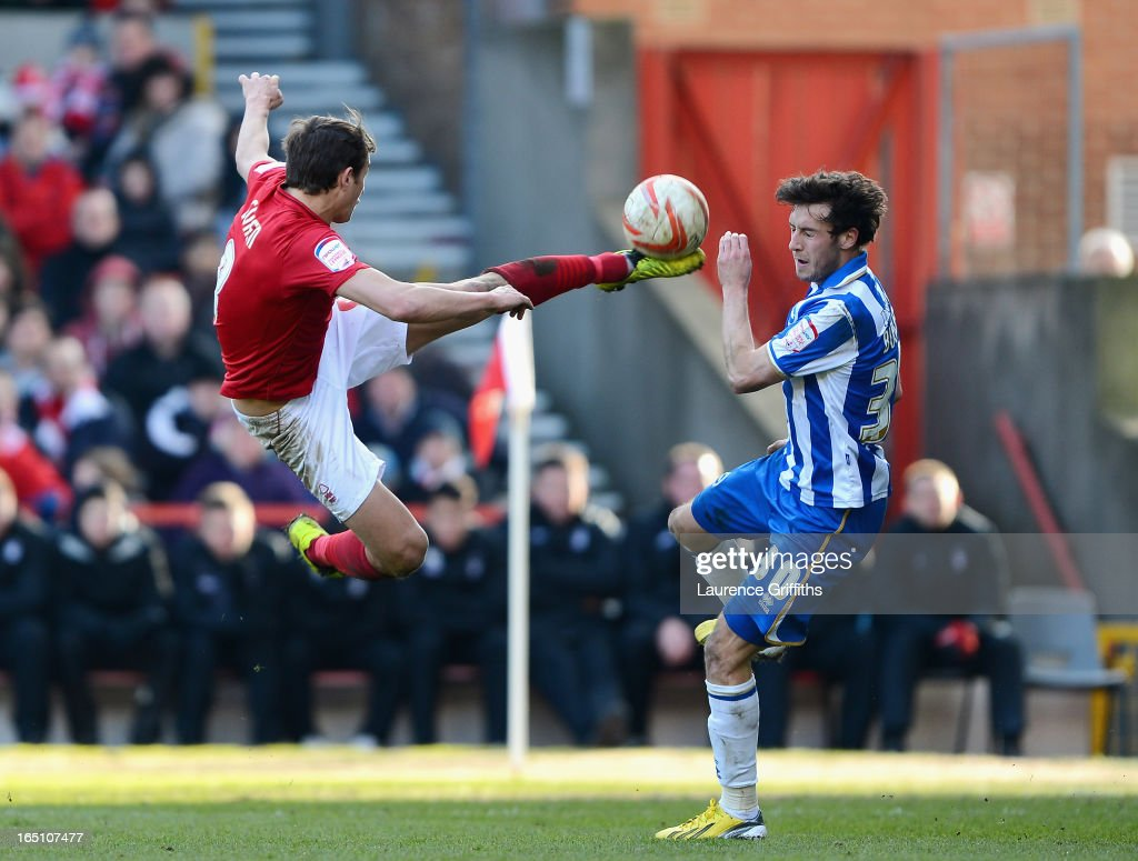 Chris Cohen of Nottingham Forest fires in a shot under pressure from Will Buckley of Brighton during the npower Championship match between Nottingham Forest and Brighton and Hove Albion at City Ground on March 30, 2013 in Nottingham, England.