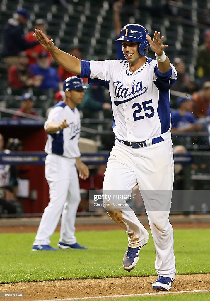 Chris Colabello #25 of Italy celebrates after Mario Chiarini #45 (not pictured) hit the game winning RBI single against Canada during the eighth inning of the World Baseball Classic First Round Group D game at Chase Field on March 8, 2013 in Phoenix, Arizona. Italy defeated Canada 14-4 by mercy rule in eight innings.