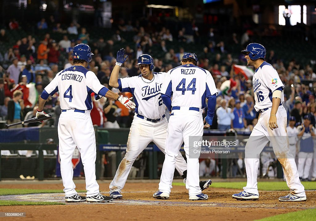 Chris Colabello of Italy is congratulated by Mike Costanzo Anthony Rizzo and Alex Liddi after Colabello hit a threerun home run against Canada during...