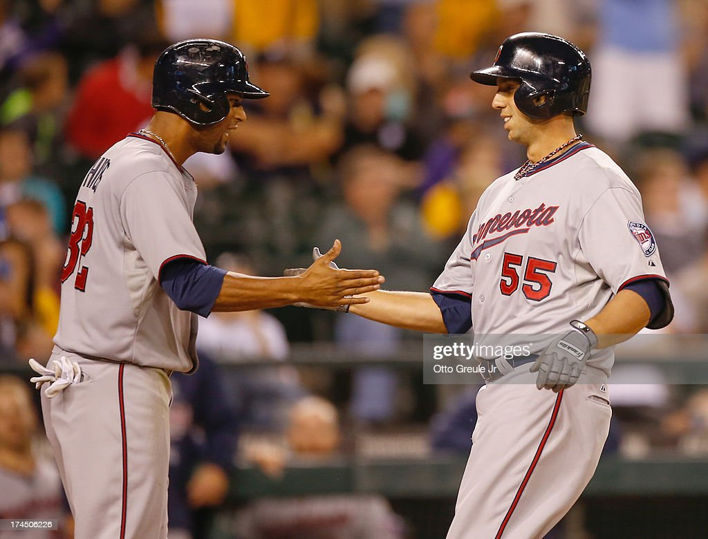 Chris Colabello #55 of the Minnesota Twins is congratulated by <a gi-track='captionPersonalityLinkClicked' href=/galleries/search?phrase=Aaron+Hicks&family=editorial&specificpeople=5471630 ng-click='$event.stopPropagation()'>Aaron Hicks</a> #32 after hitting a two-run home run against the Seattle Mariners in the thirteenth inning at Safeco Field on July 26, 2013 in Seattle, Washington.