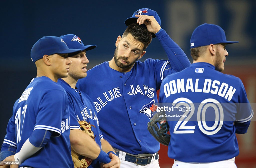<a gi-track='captionPersonalityLinkClicked' href=/galleries/search?phrase=Chris+Colabello&family=editorial&specificpeople=10524606 ng-click='$event.stopPropagation()'>Chris Colabello</a> #15 of the Toronto Blue Jays looks on during a pitching change with <a gi-track='captionPersonalityLinkClicked' href=/galleries/search?phrase=Ryan+Goins&family=editorial&specificpeople=9004043 ng-click='$event.stopPropagation()'>Ryan Goins</a> #17 (L) and <a gi-track='captionPersonalityLinkClicked' href=/galleries/search?phrase=Cliff+Pennington+-+Baseball+Player&family=editorial&specificpeople=8134145 ng-click='$event.stopPropagation()'>Cliff Pennington</a> #9 and <a gi-track='captionPersonalityLinkClicked' href=/galleries/search?phrase=Josh+Donaldson&family=editorial&specificpeople=4959442 ng-click='$event.stopPropagation()'>Josh Donaldson</a> #20 (R) during MLB game action against the Boston Red Sox on September 19, 2015 at Rogers Centre in Toronto, Ontario, Canada.