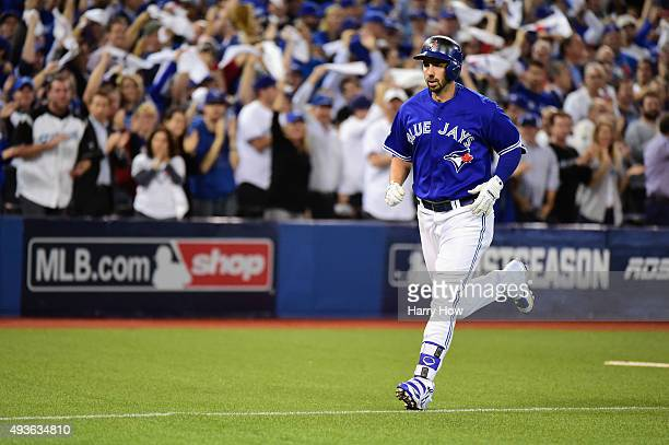 Chris Colabello of the Toronto Blue Jays runs the bases after hitting a solo home run in the second inning against the Kansas City Royals during game...
