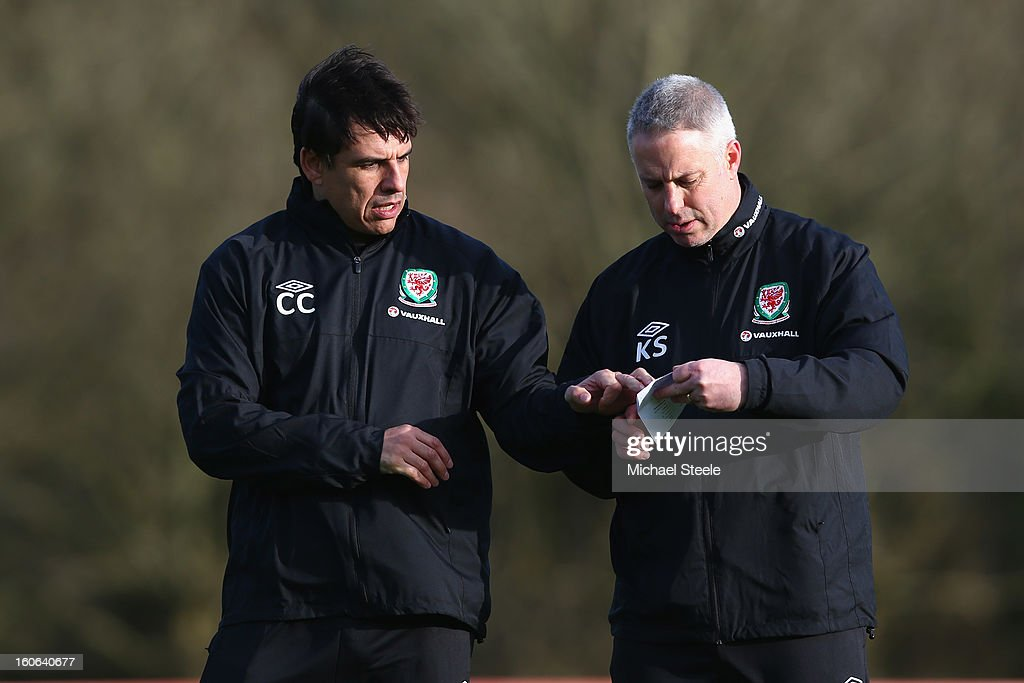 <a gi-track='captionPersonalityLinkClicked' href=/galleries/search?phrase=Chris+Coleman+-+Soccer+Manager&family=editorial&specificpeople=200674 ng-click='$event.stopPropagation()'>Chris Coleman</a> (L), manager of Wales alongside assistant coach Kit Symons (R) during the Wales training session at Hensol Castle Park on February 4, 2013 in Cardiff, Wales.