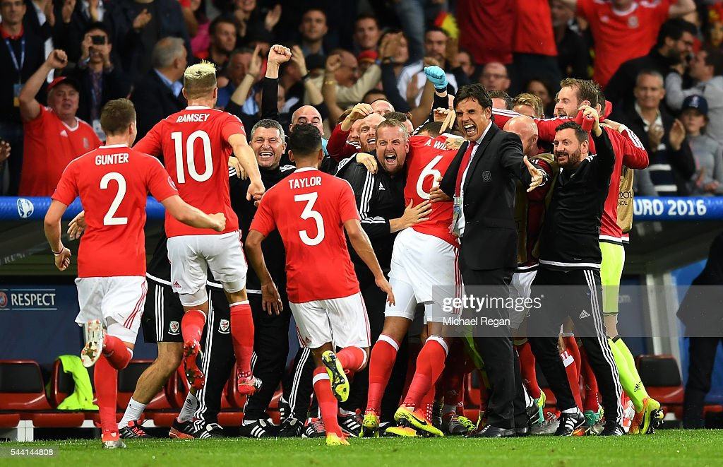 Chris Coleman manager of Wales celebrates <a gi-track='captionPersonalityLinkClicked' href=/galleries/search?phrase=Ashley+Williams+-+Soccer+Player&family=editorial&specificpeople=13495389 ng-click='$event.stopPropagation()'>Ashley Williams</a> of after scoring his team's first goal during the UEFA EURO 2016 quarter final match between Wales and Belgium at Stade Pierre-Mauroy on July 1, 2016 in Lille, France.