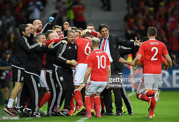 Chris Coleman manager of Wales congratulates Ashley Williams and players after his team's first goal during the UEFA EURO 2016 quarter final match...