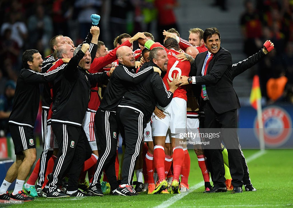 Chris Coleman (R) manager of Wales congratulates Ashley Williams of Wales after his team's first goal during the UEFA EURO 2016 quarter final match between Wales and Belgium at Stade Pierre-Mauroy on July 1, 2016 in Lille, France.