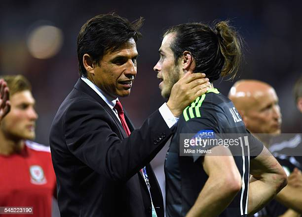 Chris Coleman manager of Wales consoles Gareth Bale of Wales after defeat in the UEFA EURO 2016 semi final match between Portugal and Wales at Stade...