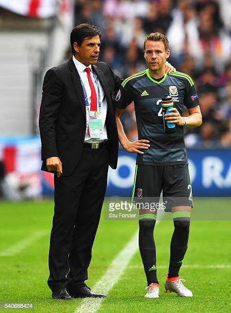 Chris Coleman manager of Wales talks with Chris Gunter of Wales during the UEFA EURO 2016 Group B match between England and Wales at Stade...