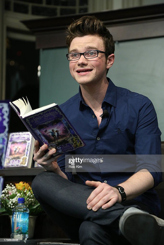 <a gi-track='captionPersonalityLinkClicked' href=/galleries/search?phrase=Chris+Colfer&family=editorial&specificpeople=5662110 ng-click='$event.stopPropagation()'>Chris Colfer</a> signs copies of his new book 'The Land of Stories: The Enchantress Returns' at Barnes & Noble Union Square on August 6, 2013 in New York City.